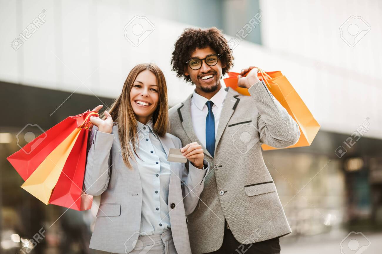 Couple in shopping. Happy couple with shopping bags and credit card enjoying in shopping. - 153525835