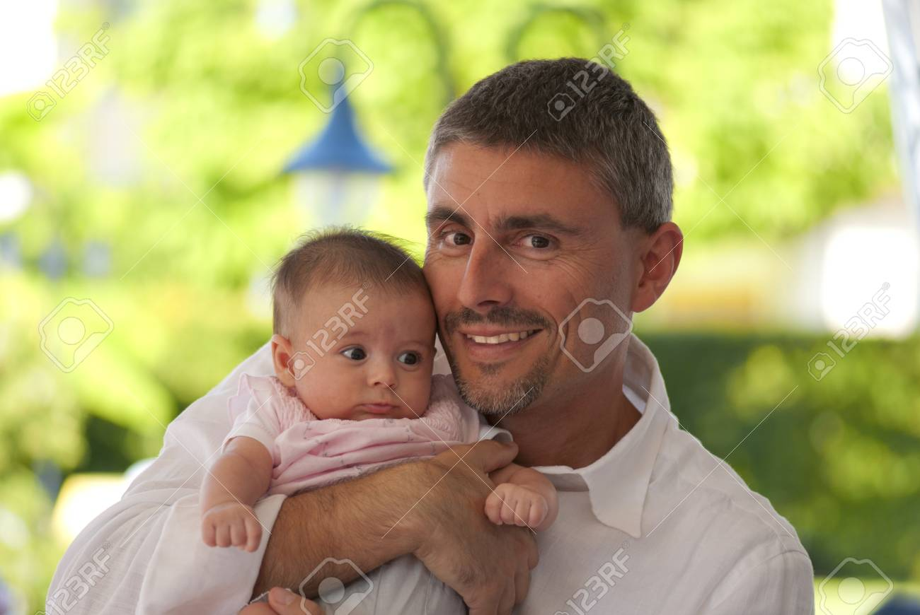 Father Hugging his Daughter at a Party, Italy Stock Photo - 8897166