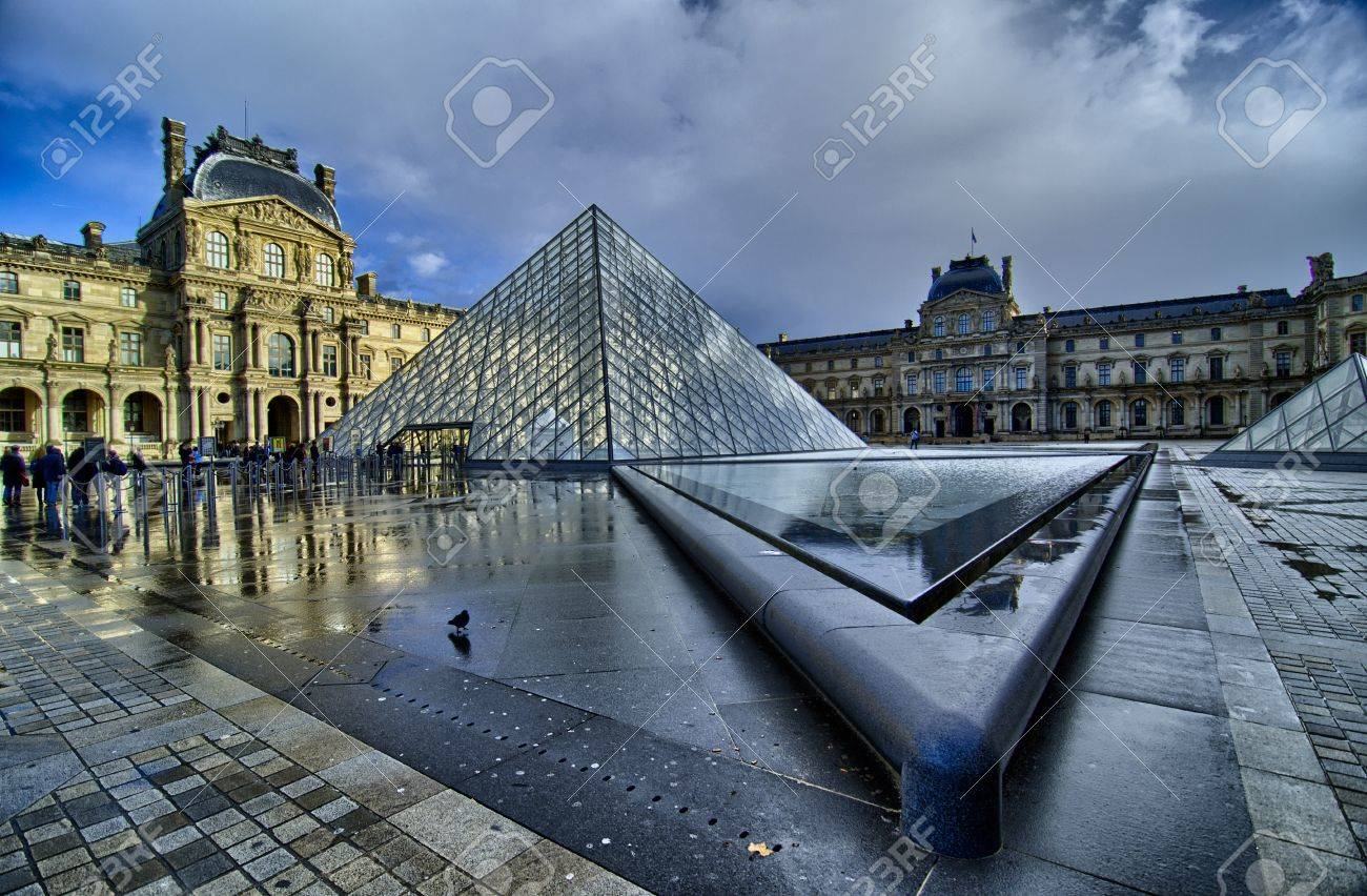 PARIS - NOV 16: Louvre Pyramid reflects on Water on November, 16, 2011 in Paris. The Louvre contains more than 380.000 objects and displays 35.000 artworks in eight departments Stock Photo - 16322700
