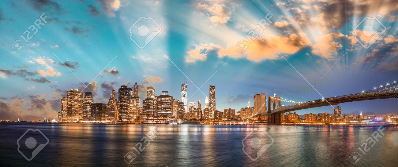 Dramatic sky over Brooklyn Bridge and Manhattan, panoramic night view of New York City - 31785077