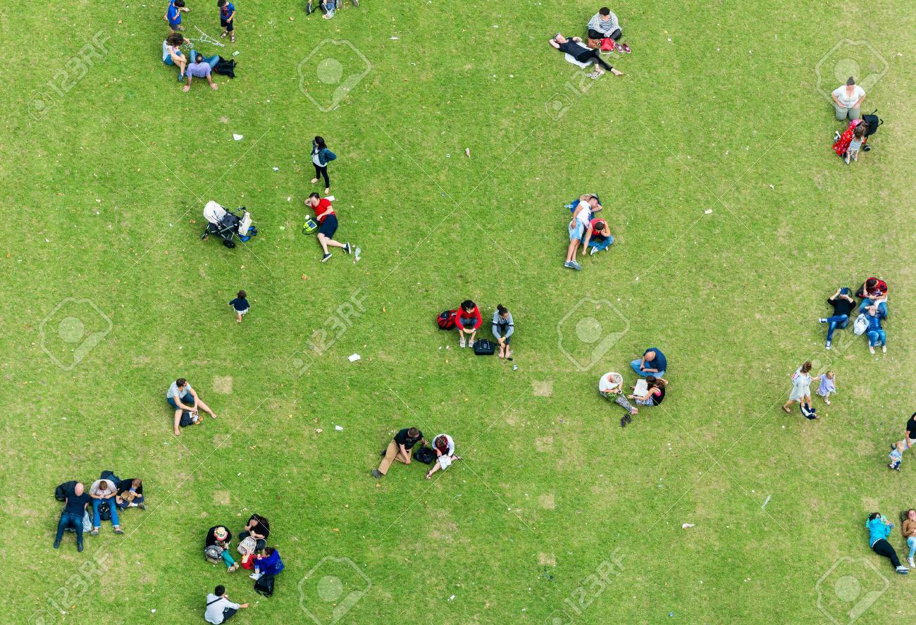 Ninety degrees view of people relaxing on a meadow. Banque d'images - 40360122