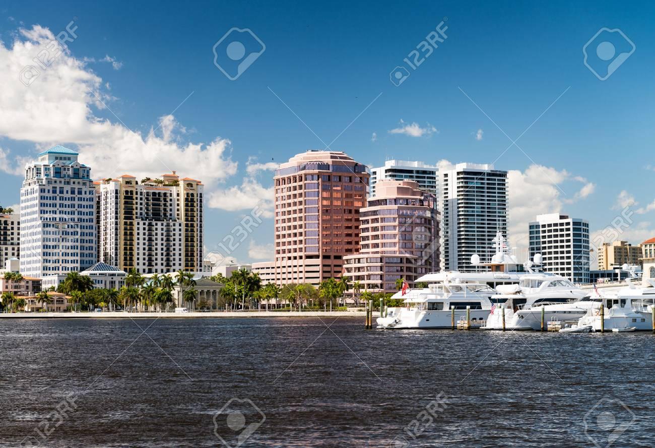 West Palm Beach, Florida. Panoramic city skyline on a beautiful sunny day - 65507612