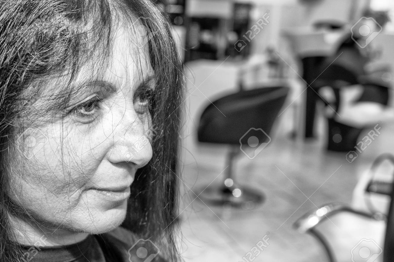 Woman In 40s Having Haircut In Beauty Salon Stock Photo Picture