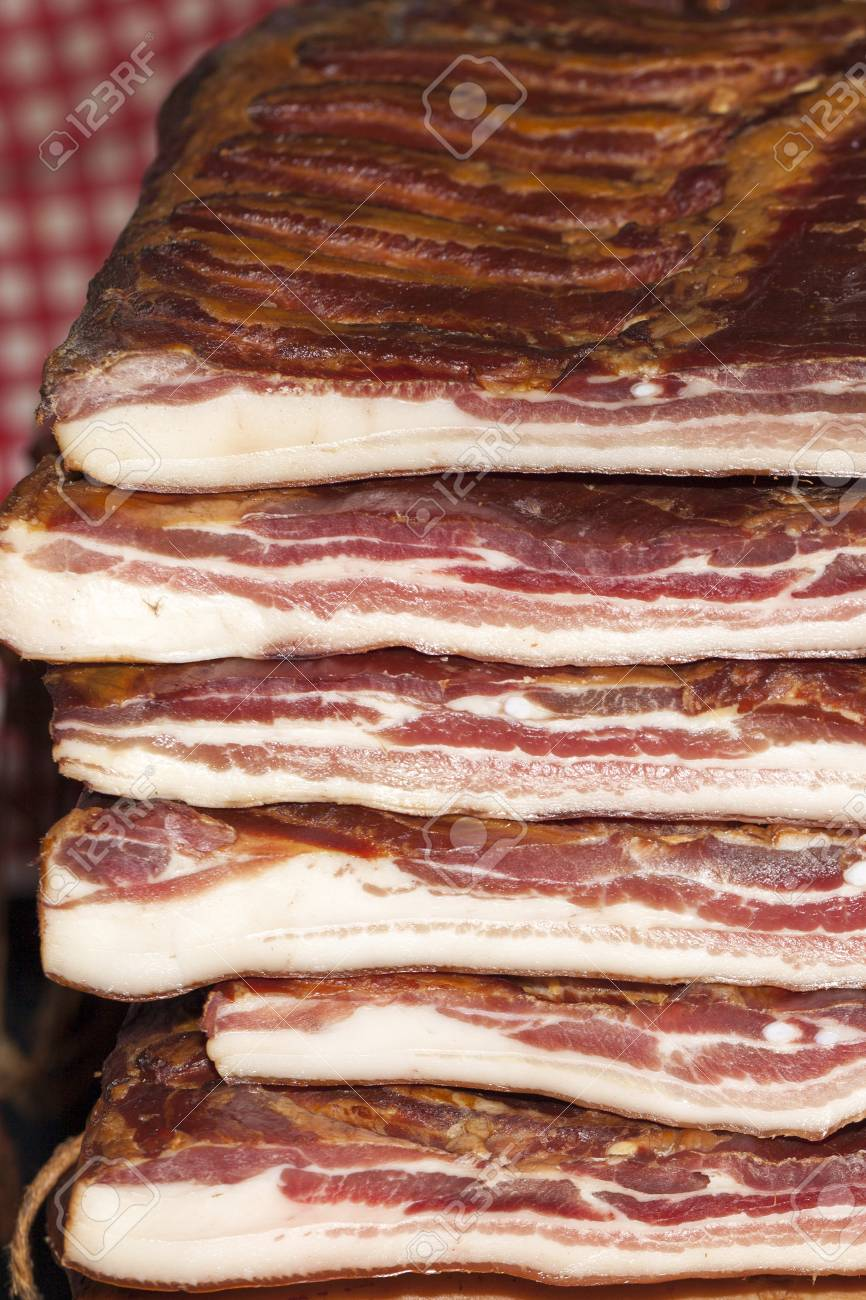 Homemade, very tasty smoked bacon, cut into big piece Stock Photo - 79313770