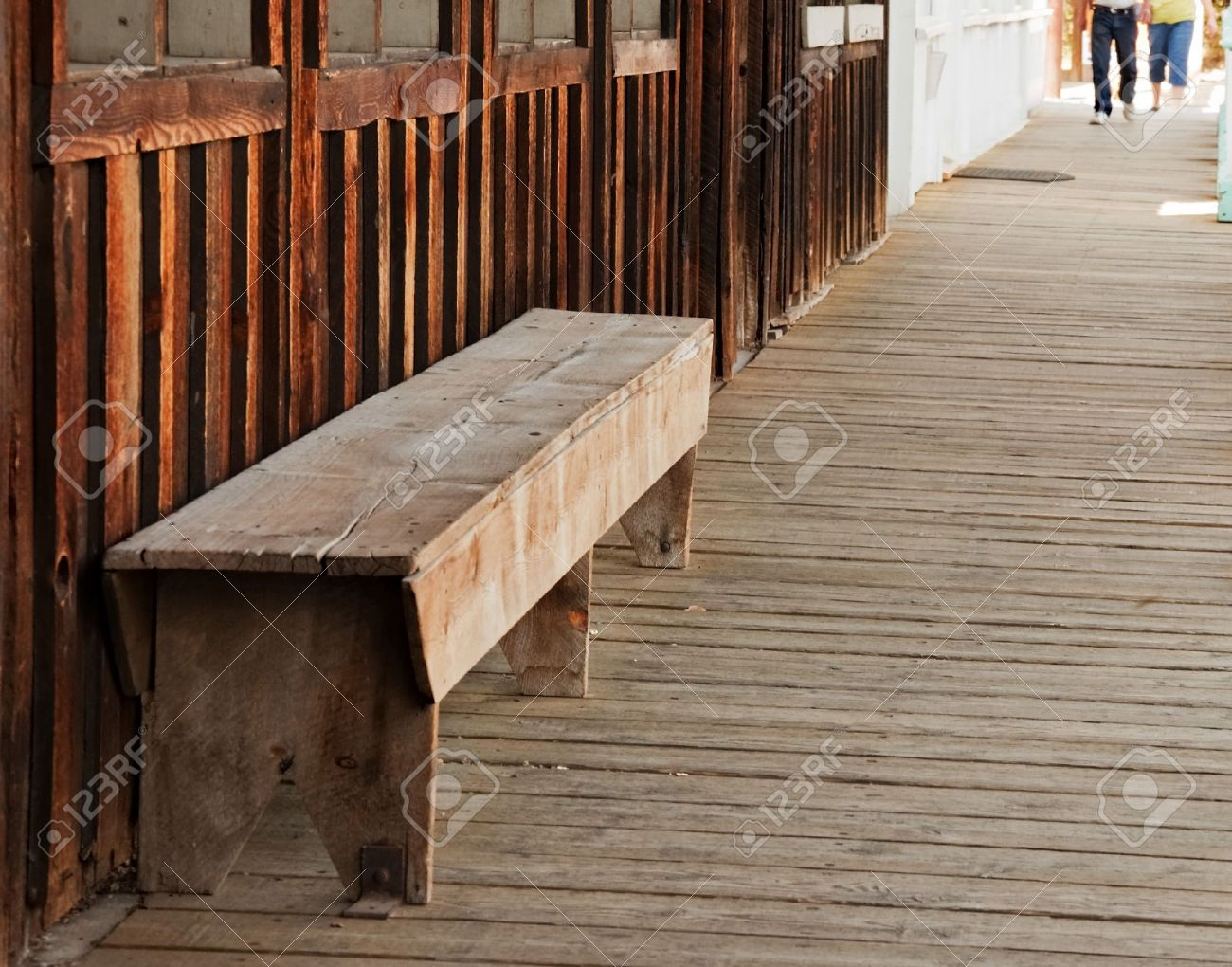 A Wood Bench Seat Is Located On A Old Wild West Themed Wooden