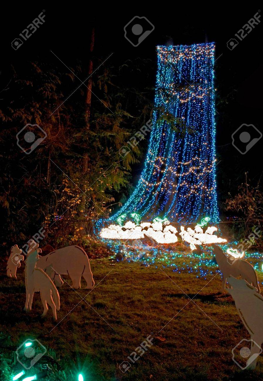 this outdoor nature scene at night is a cascade of blue and green christmas lights to - Blue And Green Christmas Lights