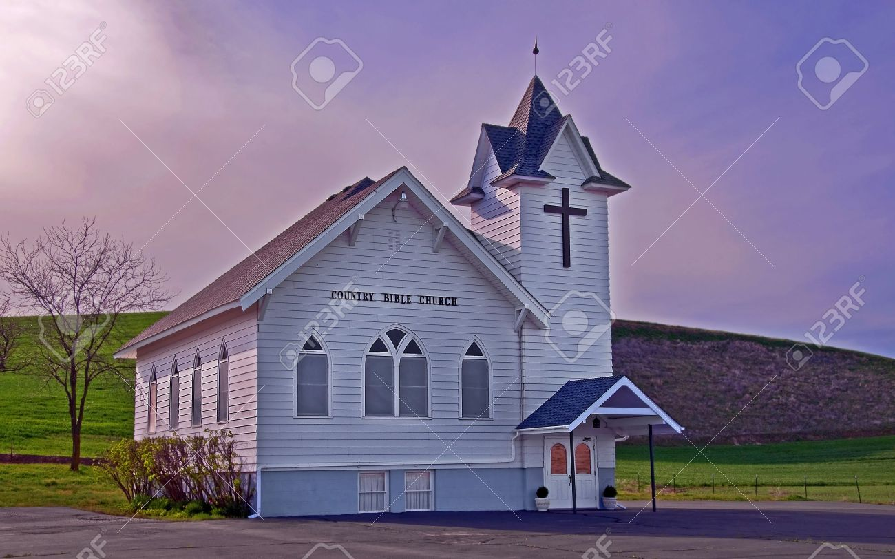 This Classic White Country Church Is Located In Rural Dusty Stock