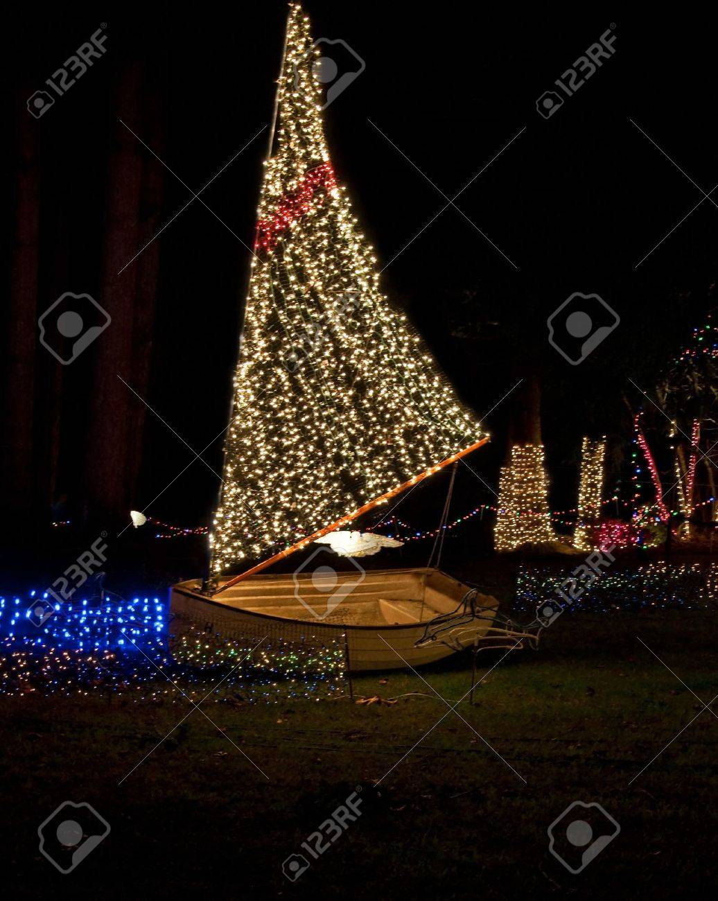 This Vertical Holiday Image Is A Sailboat With Christmas Lights At Night  For A Holiday Display
