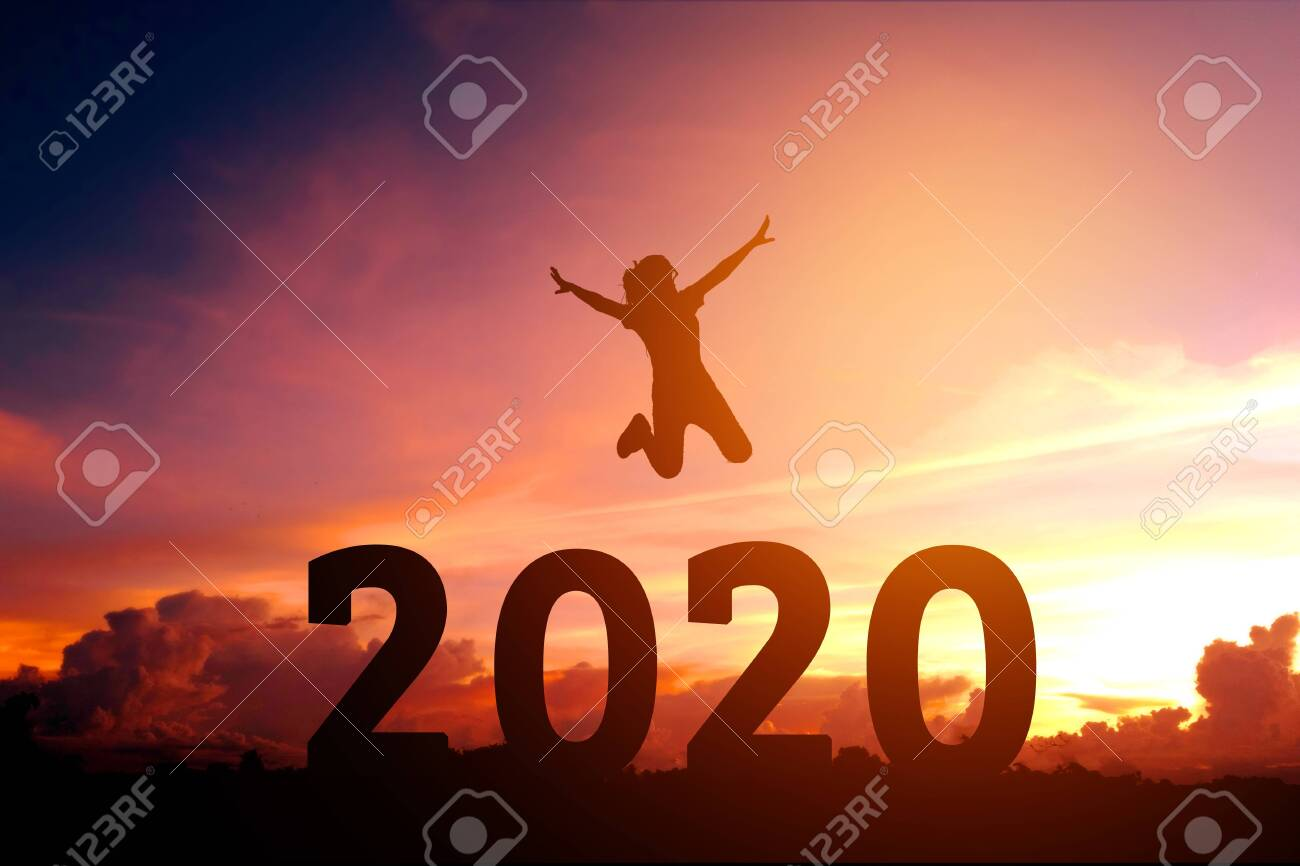 2020 Newyear Silhouette young woman jumping to Happy new year concept. - 125792803