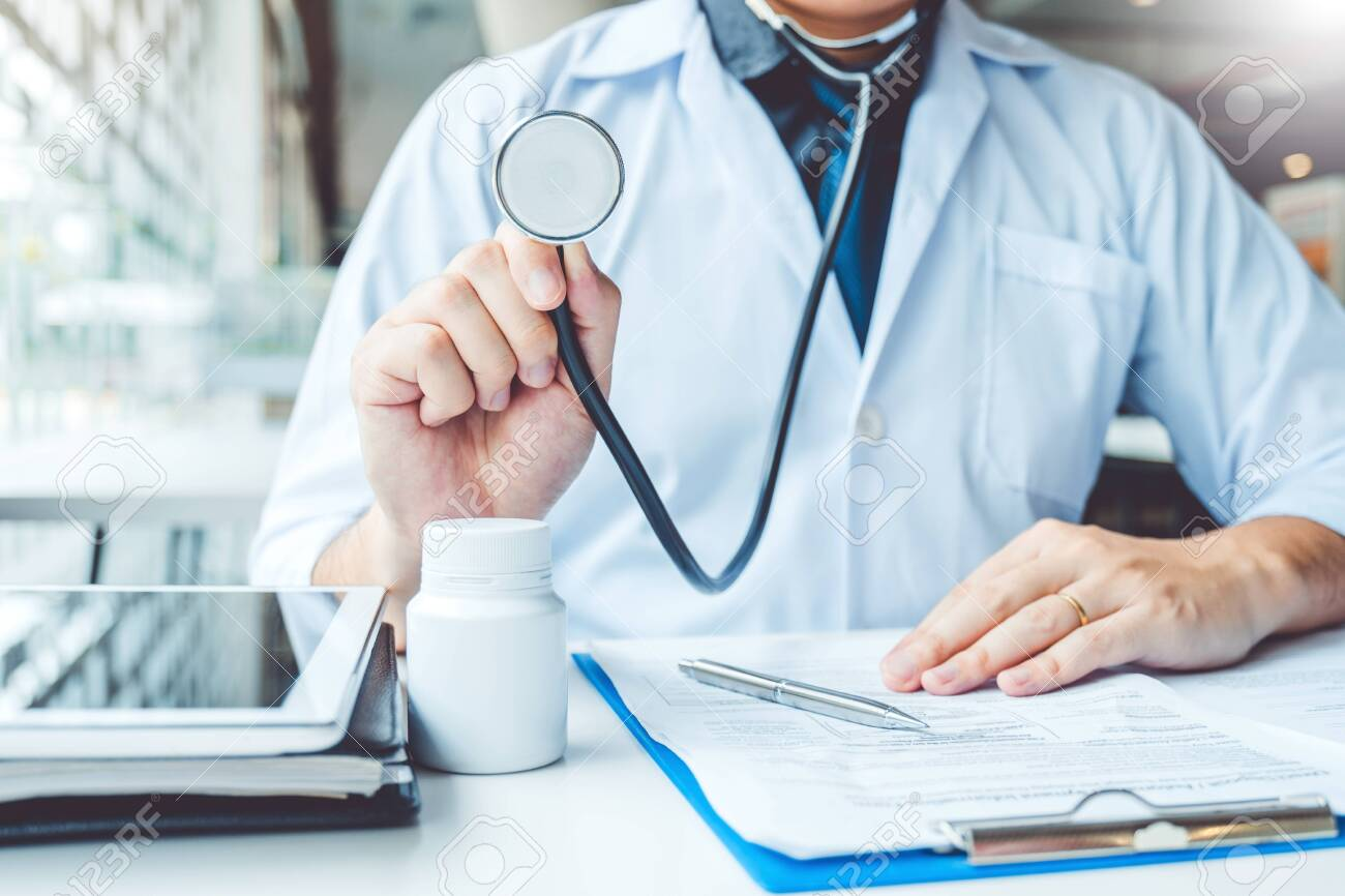 Doctor holding a stethoscope blood pressure man patient Health care in hospital - 131852665