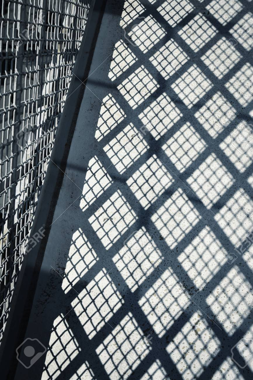 Abstract Background Shade Wire Mesh Rails On Concrete Stock Photo ...