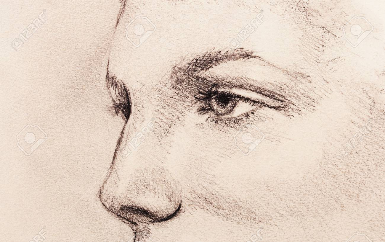 Beautiful woman eye pencil drawing on old paper