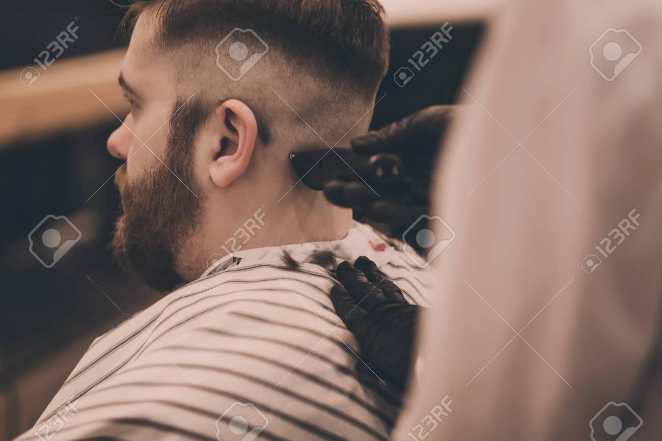 Young hipster man visiting barbershop - 140629367