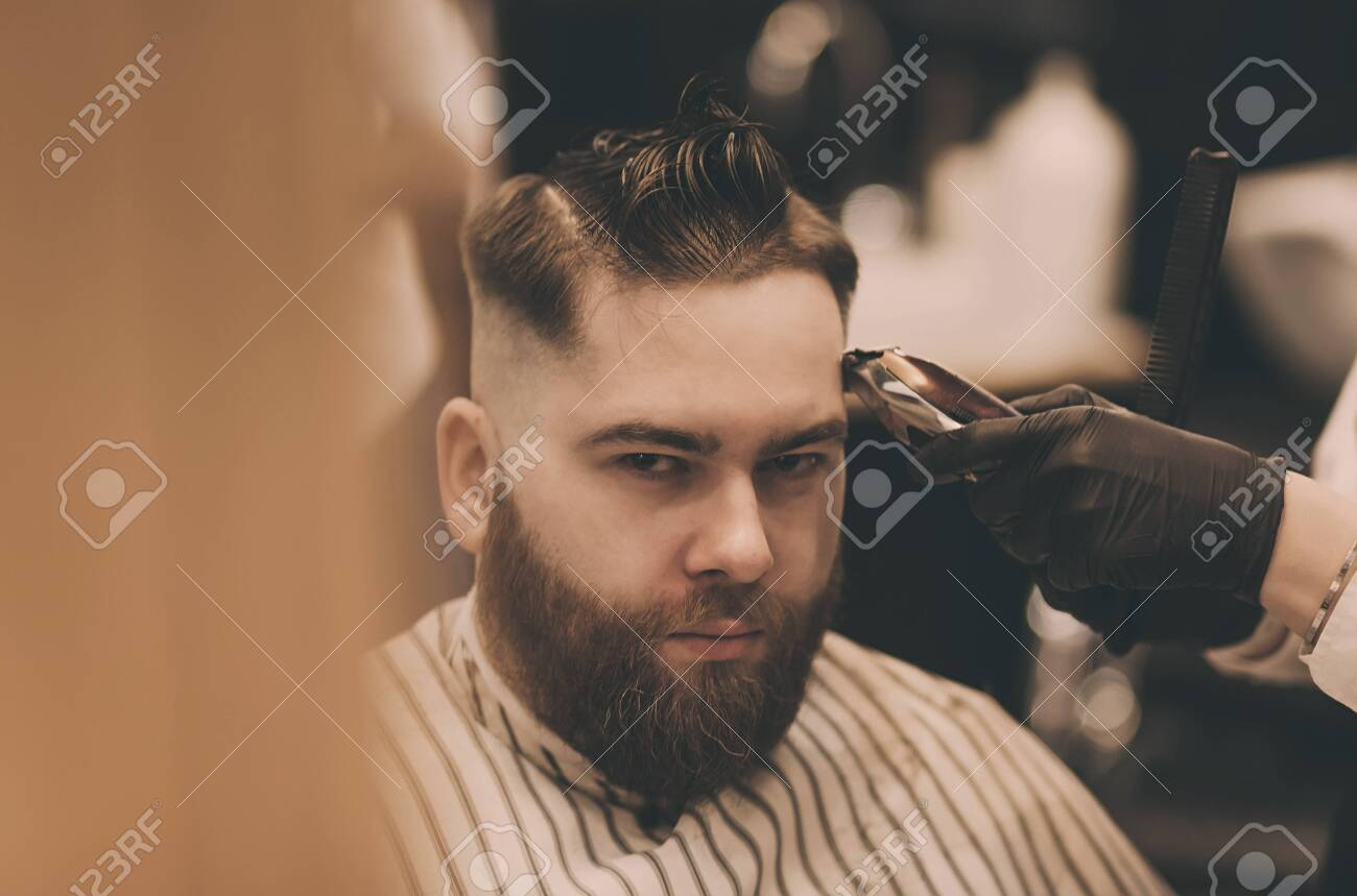 Young Man With Trendy Haircut At Barber Shop Barber Does The Stock Photo Picture And Royalty Free Image Image 140629133