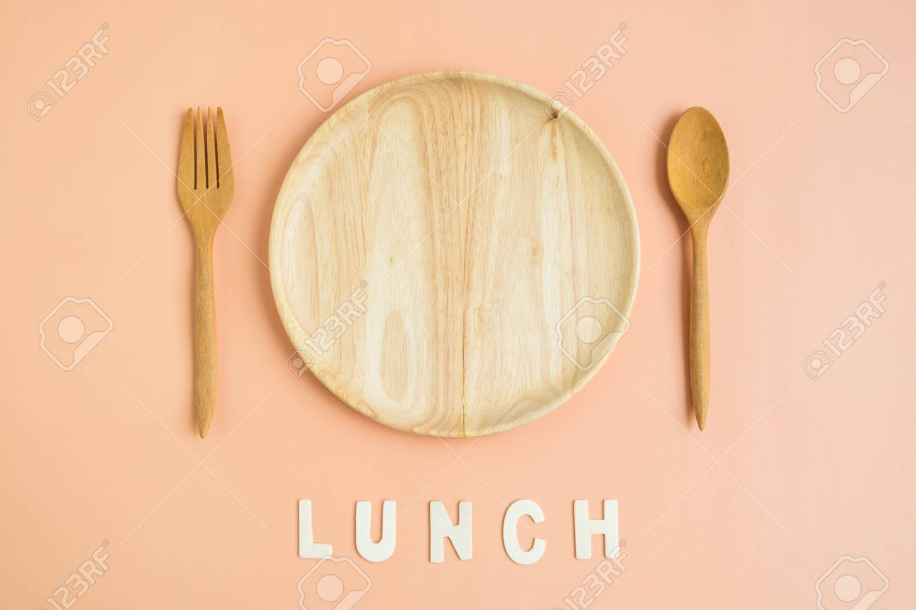 Top View Of Wooden Dish Fork Spoon With Lunch Wording On Light