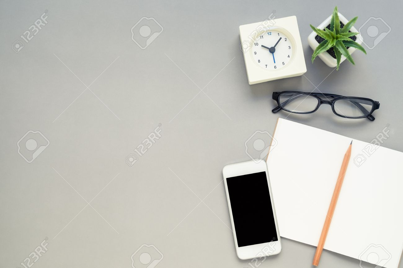 Desk Above, Table Top View Of Office Desk With Notebook, Pencil, Mobile  Phone