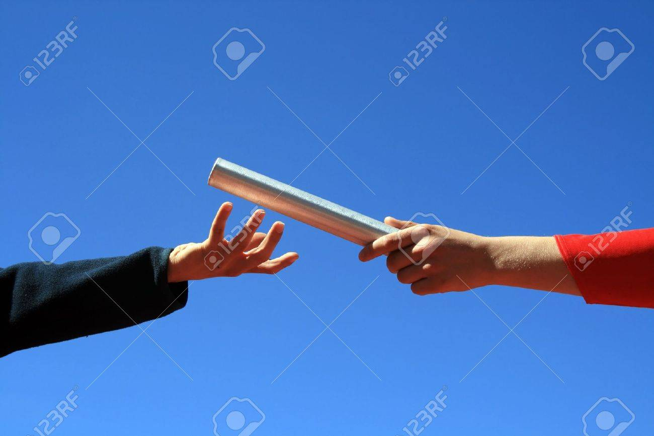 hands passing the batton against blue sky Stock Photo - 2973254