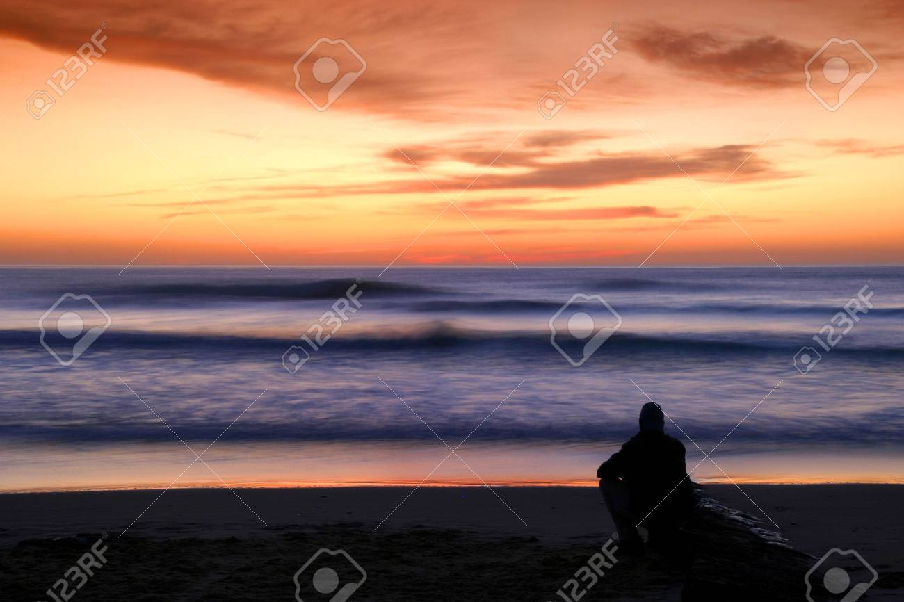 man alone watching sunset in the beach Stock Photo - 4492393