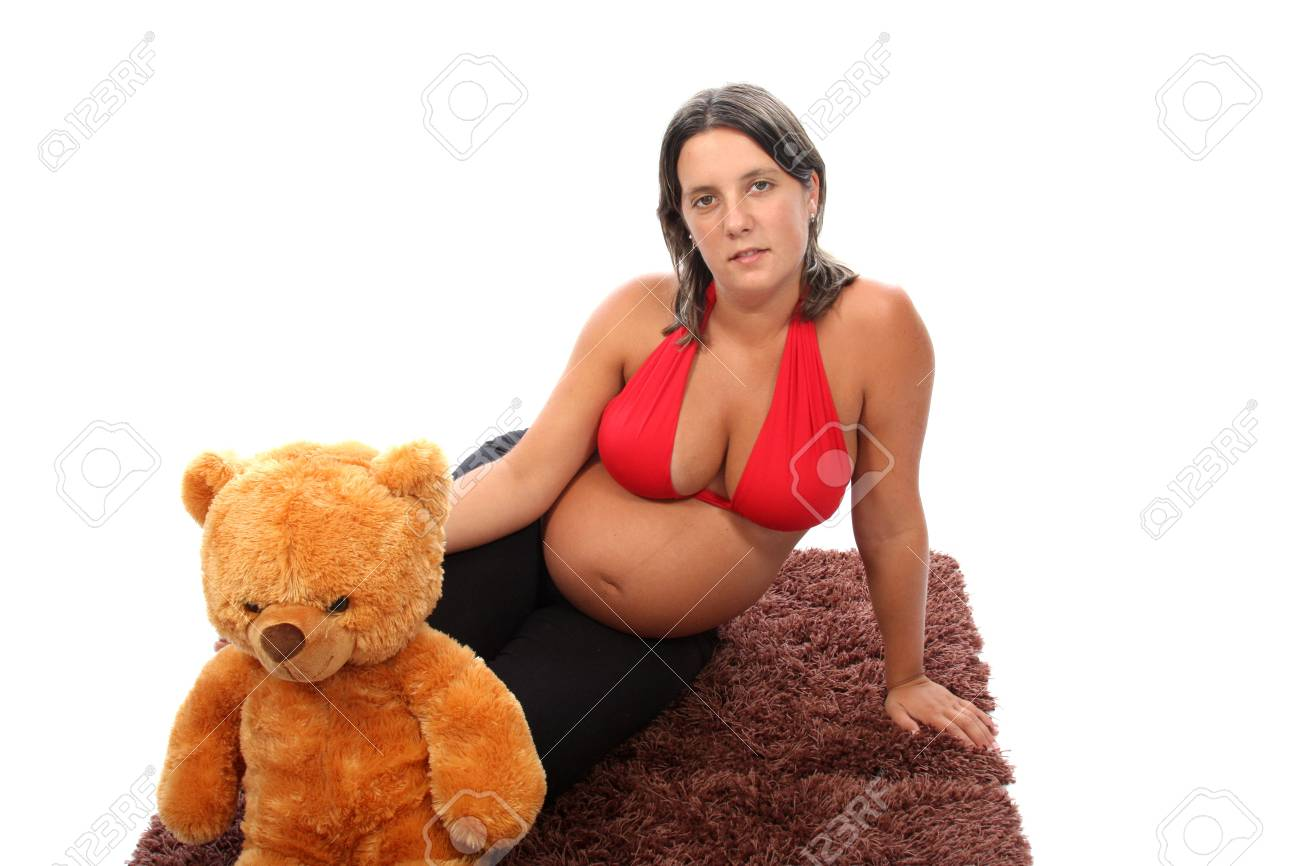 beautiful pregnant woman with beautiful belly and teddy bear Stock Photo - 13885951