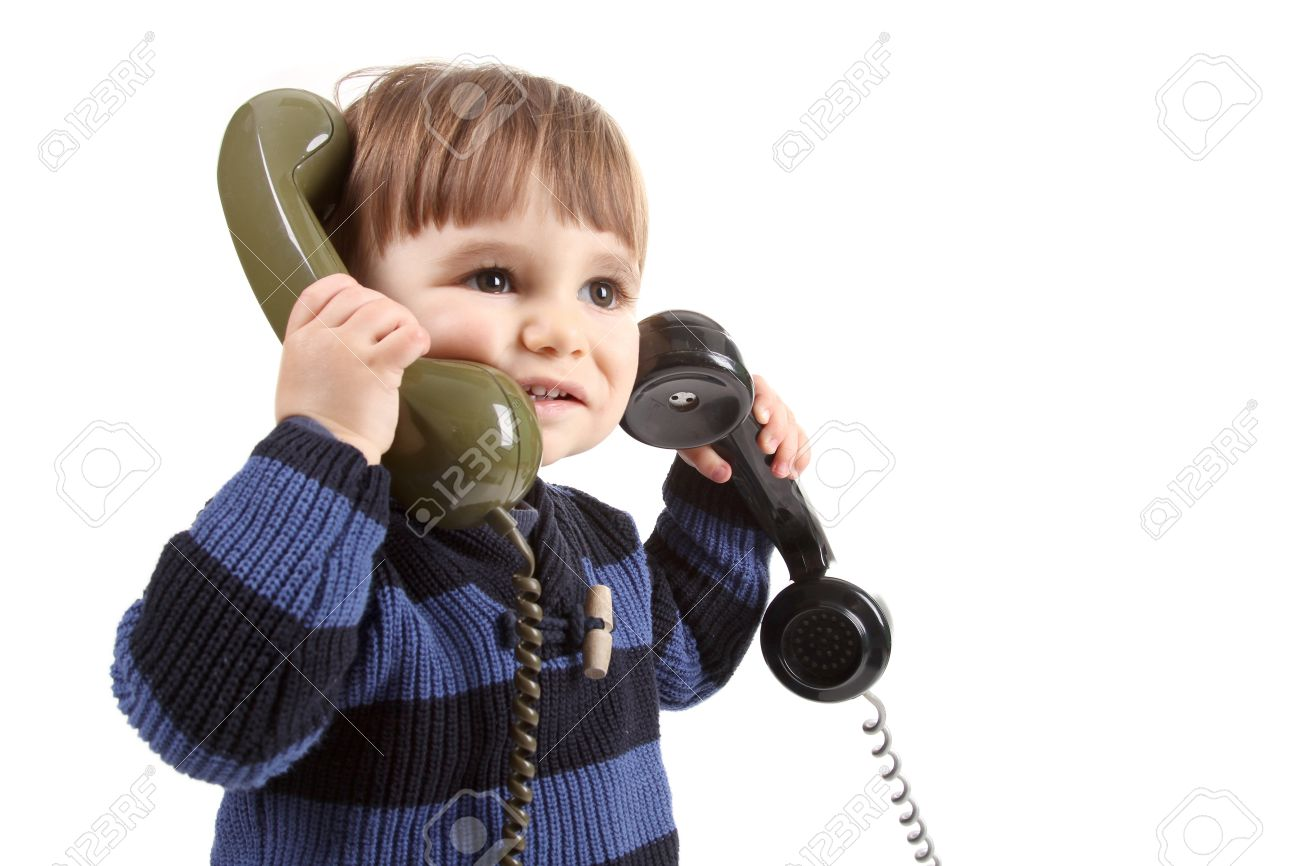 small child in a call center with two phones Stock Photo - 13885906