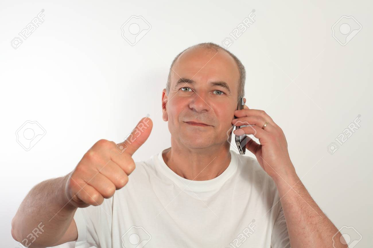 Happy senior man while talking on a mobile cell phone Stock Photo - 14204128