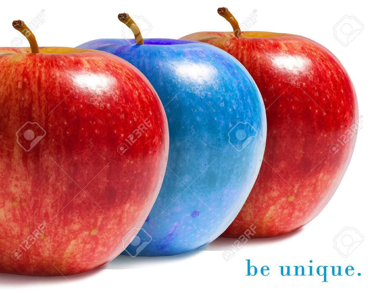 Blue apple between red ones. - 47310062