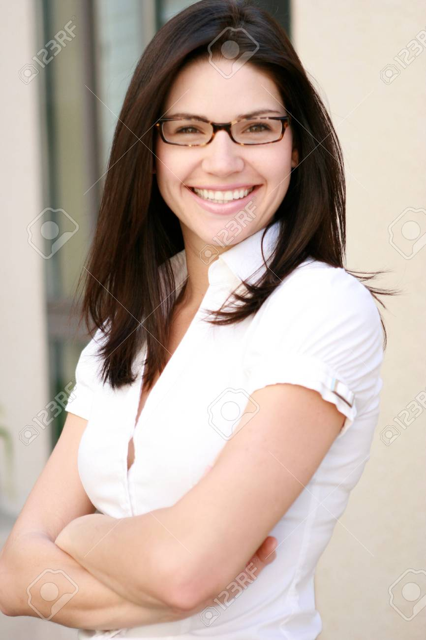 Beautiful business woman looks at camera Stock Photo - 4716100
