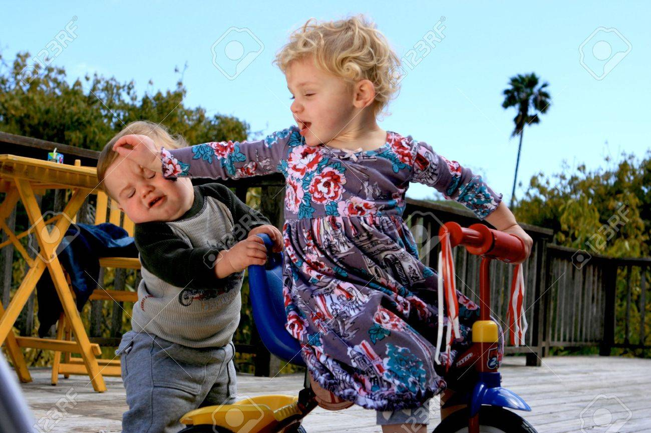 Cute little boy and his sister playing a little rougher than usual - 4723075