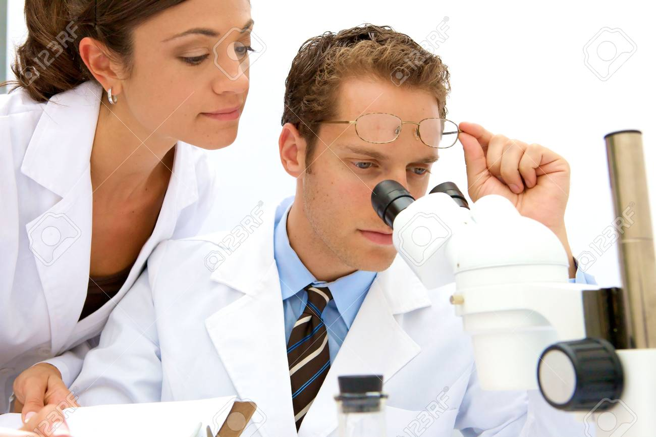 A female and male scientist working in a lab Stock Photo - 5559231