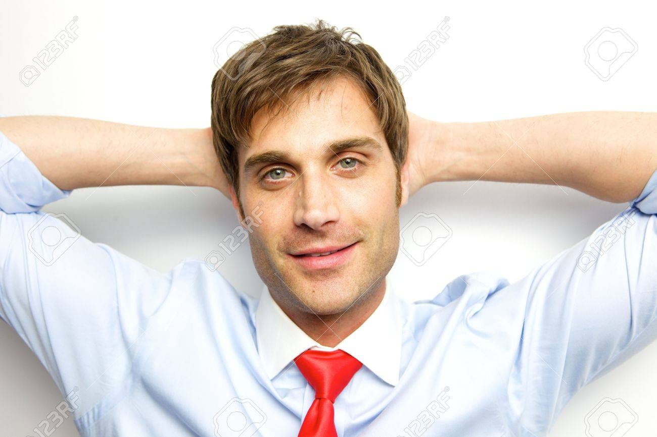 Young Businessman sitting back with his arms behind his head Stock Photo - 6355941