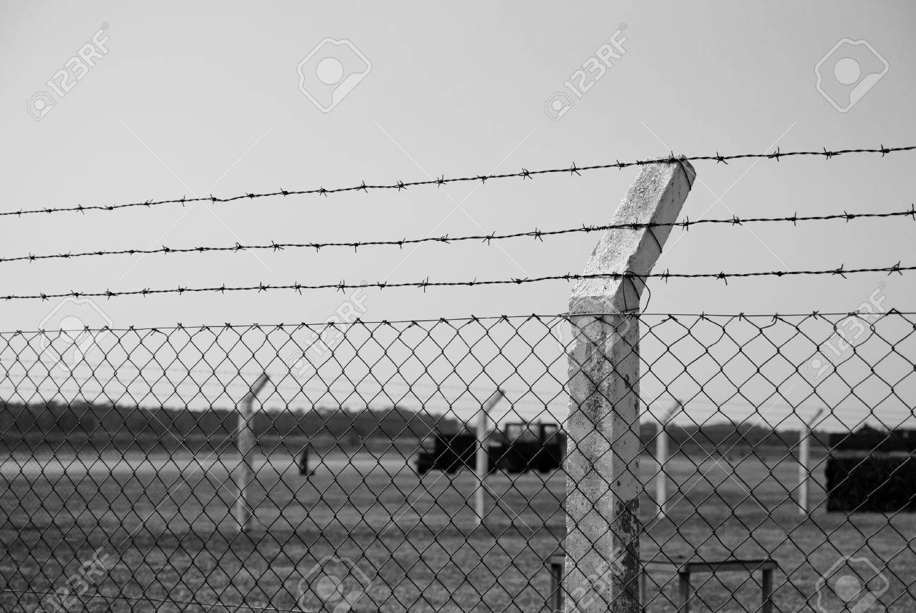 A Shot Of A Barbed Wire Fence, In A Military Environmente, Taken ...