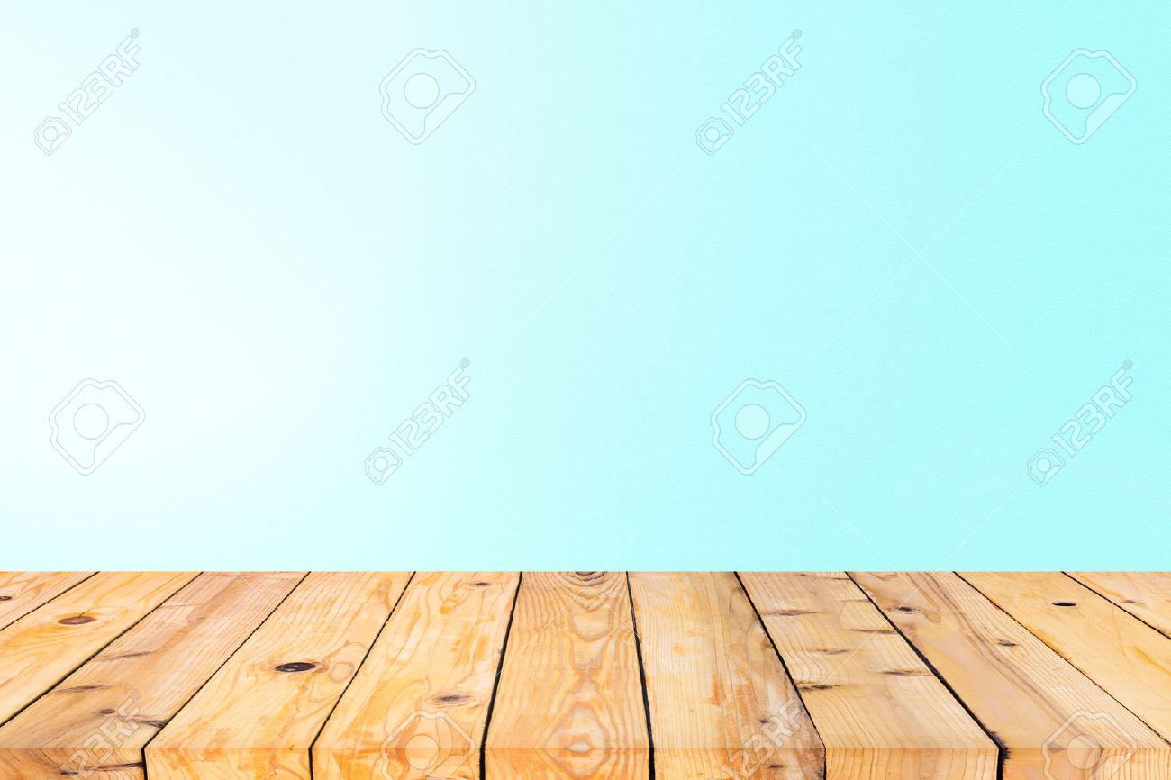 Wood Table Top On Blue Wall Background Stock Photo, Picture And