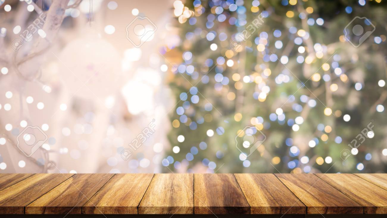 Wood Table Top On Blur Christmas Tree Background For Display