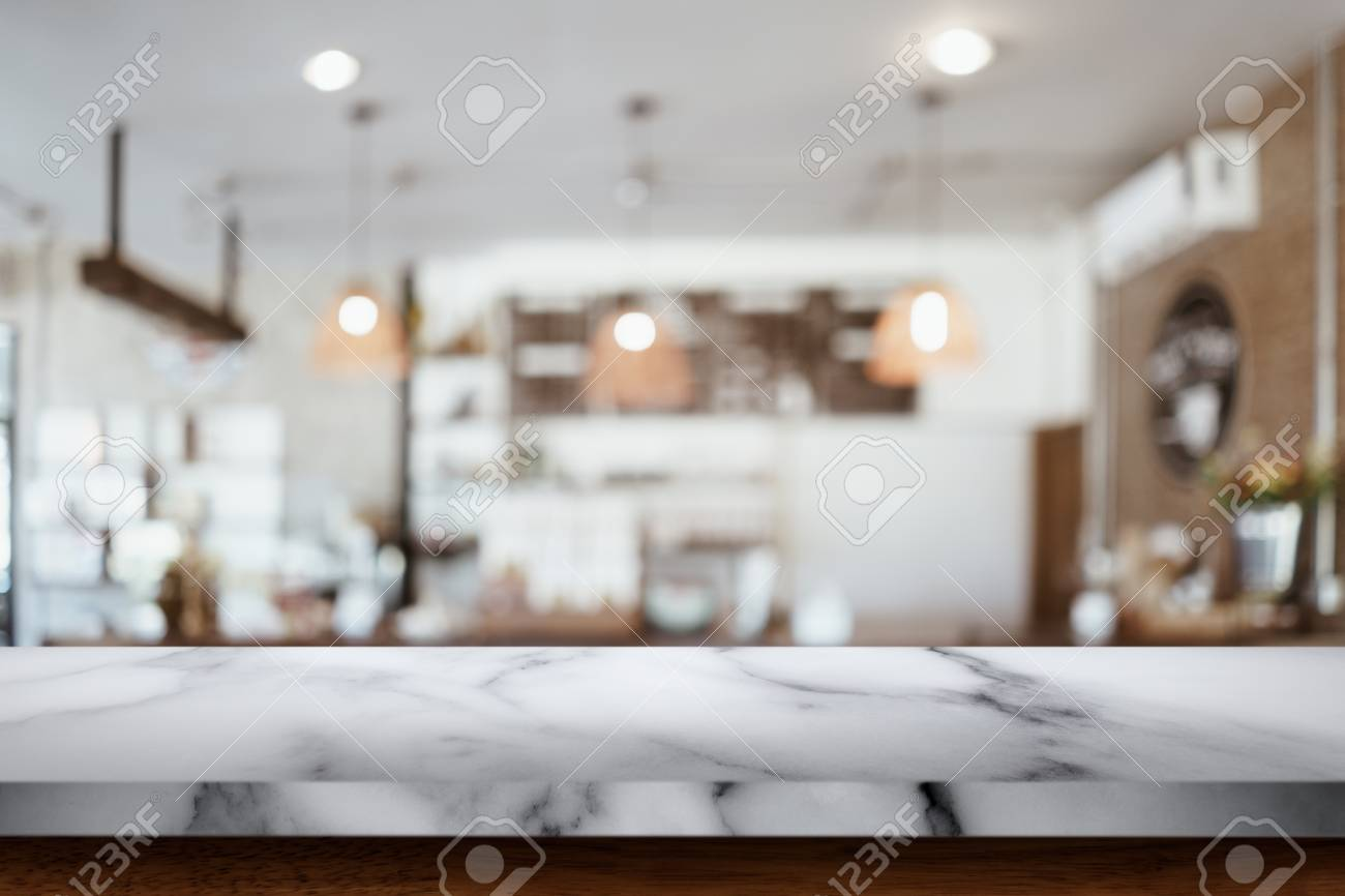 Empty Top Of White Marble Table With Blur Cafe Or Coffee Shop Stock Photo Picture And Royalty Free Image Image 111174202