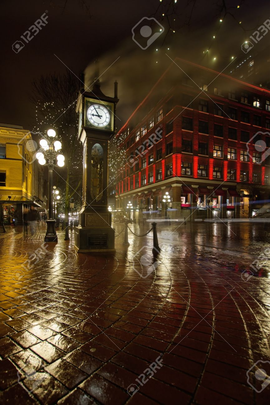 Gastown Steam Clock in Vancouver BC Canada on a Rainy Night with Historic Red Building Stock Photo - 12384007