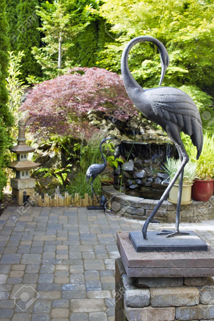 Bronze Cranes Sculpture In Japanese Inspired Zen Garden With Pagoda And  Waterfall Stock Photo   14412720