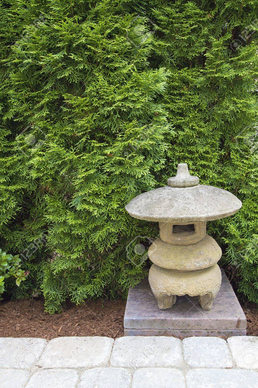 Japanese Stone Pagoda In Backyard Garden Paver Patio Stock Photo   14461437