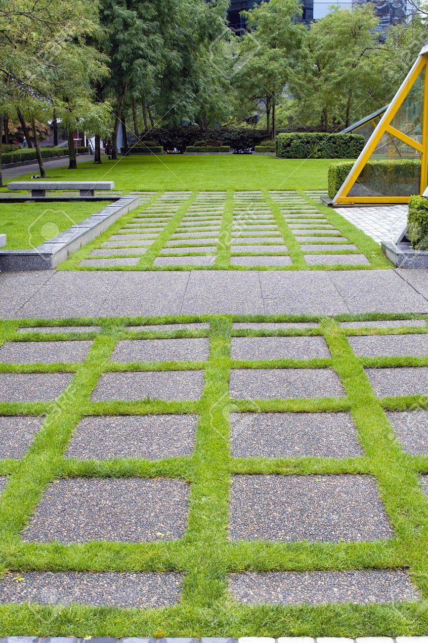 How to plant ground cover between pavers - Grass Growing Between Concrete Pavers In Public Parks Landscaping Stock Photo 15035876