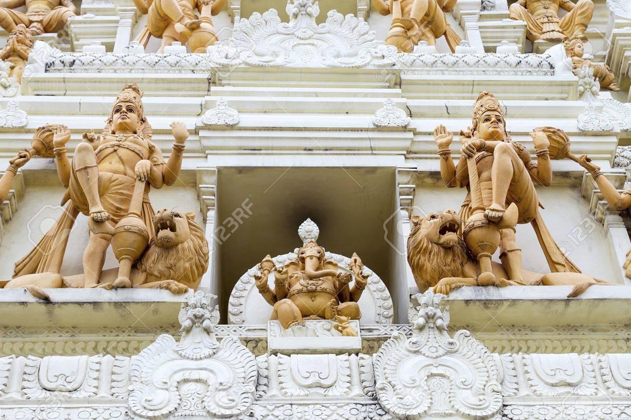 Ornate hindu ganesha god and goddesses temple gopuram tower stone