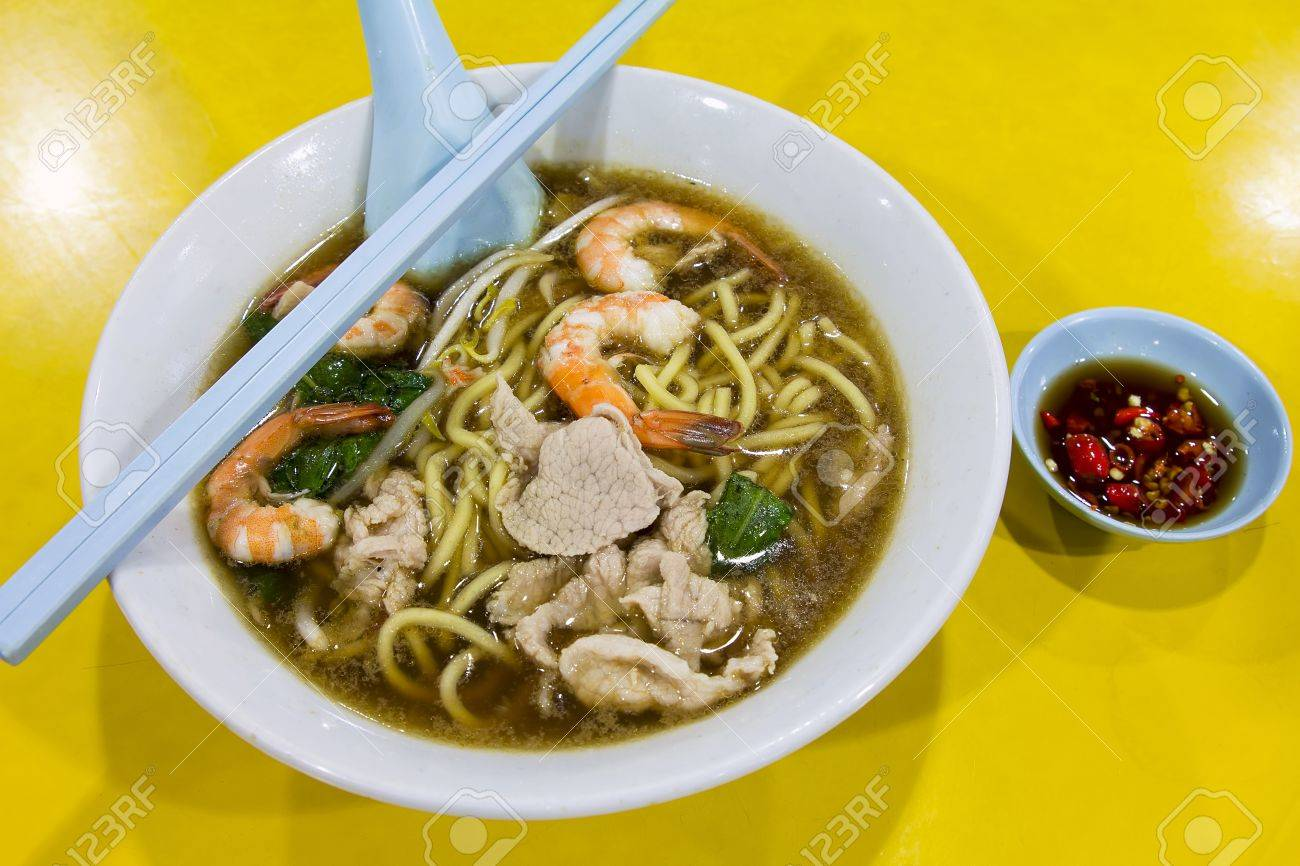 Hokkien Prawn Mee Soup Noodles with Pork and Vegetables and Side Dish of Cut Red Chili Peppers in Soy Sauce Stock Photo - 18868521