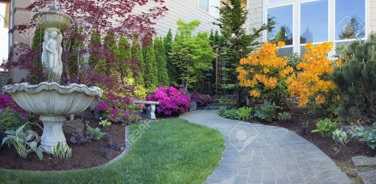 Frontyard Landscaping With Water Fountain And Brick Pavers Path