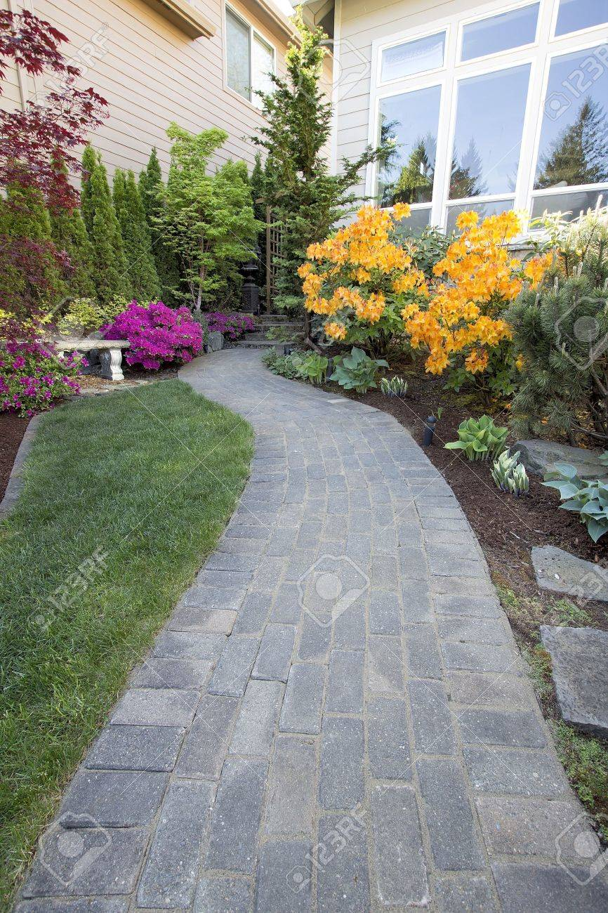 Garden Brick Paver Path Walkway with Green Grass Lawn and Landscaping Plants Stock Photo - 19508575