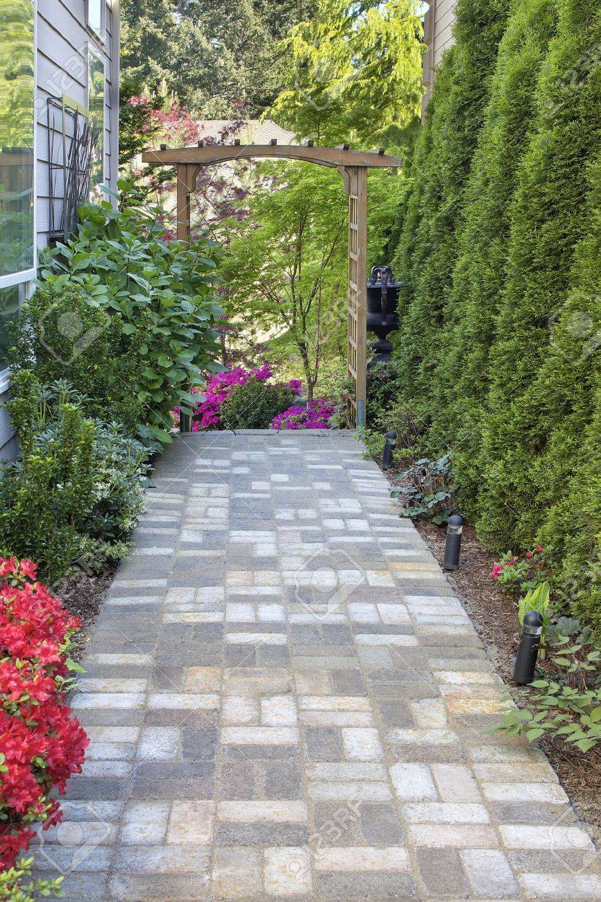 Garden Brick Paver Path Walkway With Wood Arbor Landscape Light