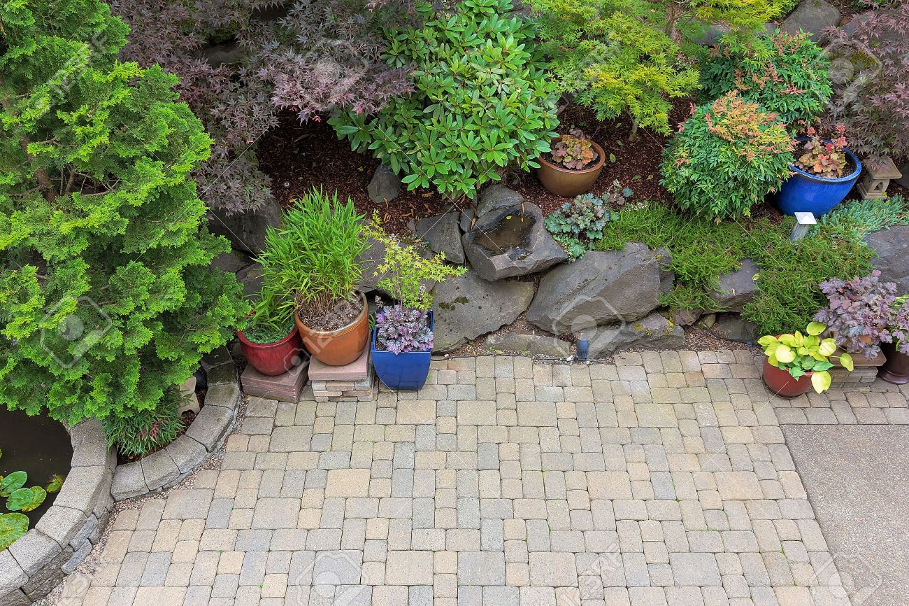 backyard garden landscaping with paver bricks patio hardscape