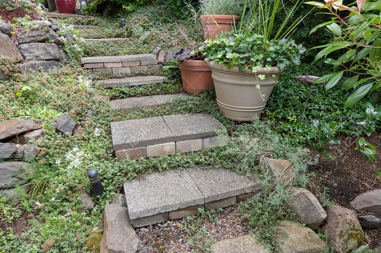 Cement Stone Steps With Groundcover Potted Plants Rocks Bricks Gravel  Leading To Garden Backyard Stock Photo