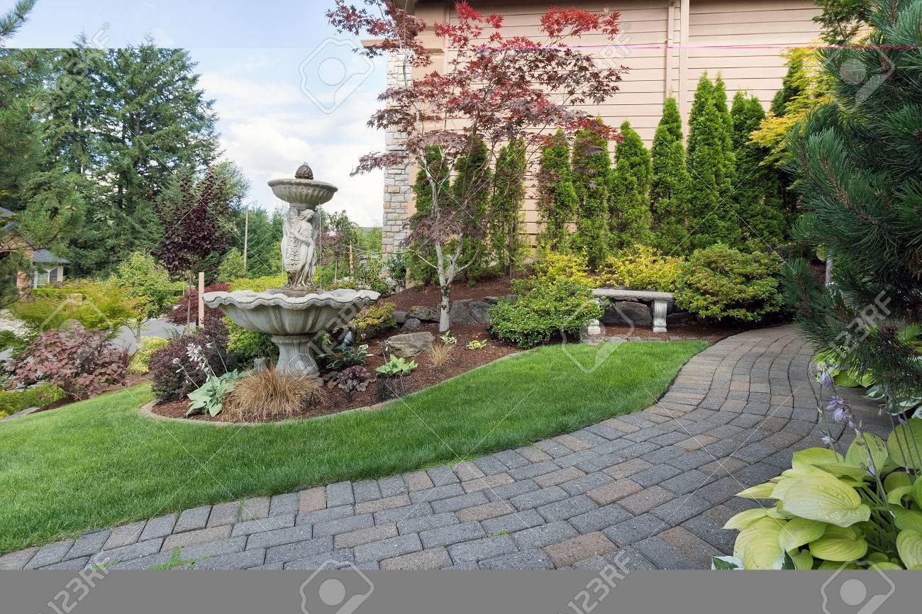 House Manicured Frontyard Garden With Water Fountain Stone Bench