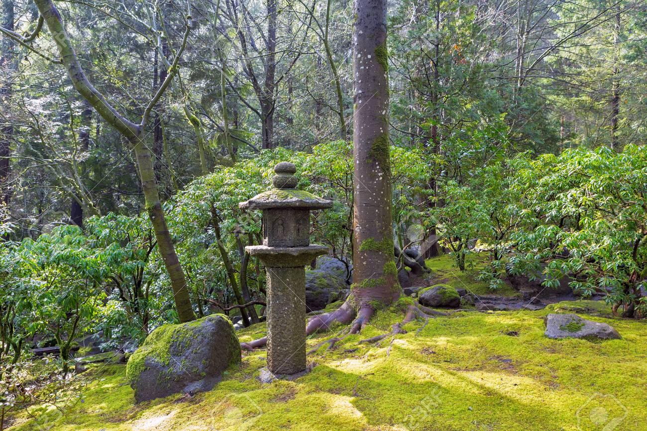 Stock Photo   Stone Pagoda Lantern Sculpture At Japanese Garden With Trees  Shrubs Rocks Moss Landscaping