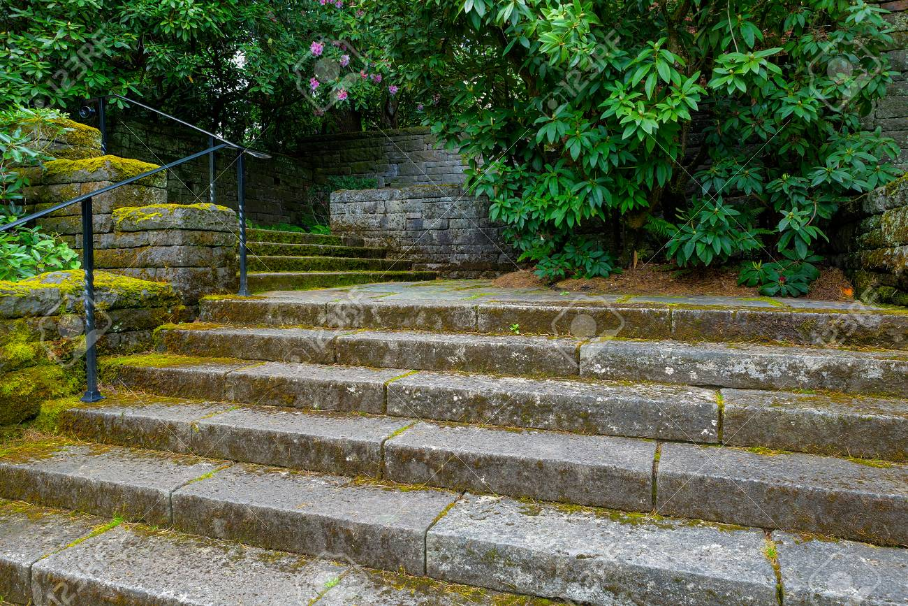 Great Old Stone Stair Steps In Renaissance Garden With Plants And Shrubs During  Spring Season Stock Photo