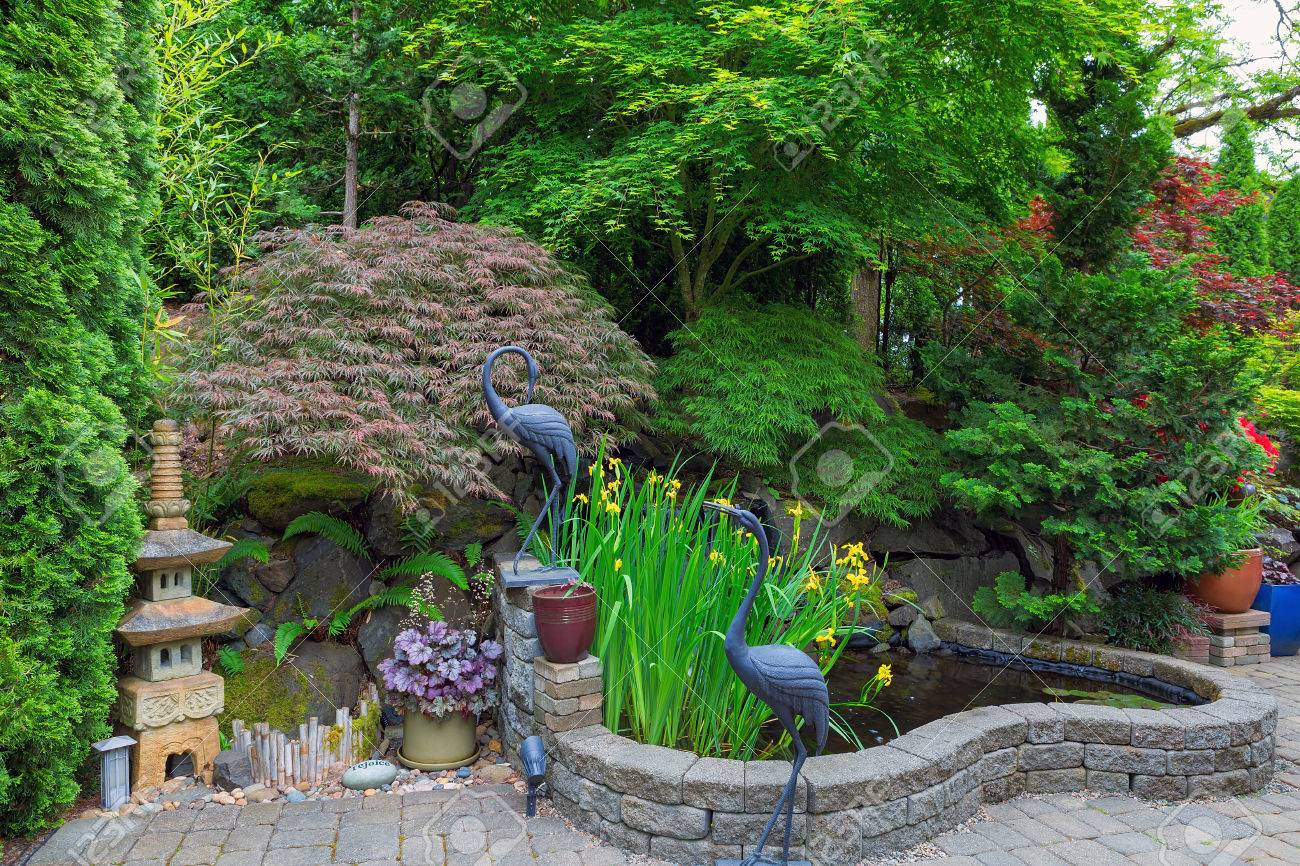 Home Garden Backyard With Lush Plants Japanese Landscaping Pond Stone  Pagoda Bronze Cranes And Paver Brick