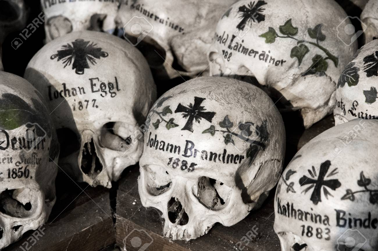 Skulls Painted With Names, Colorful Flowers And Crosses In The Charnel House  Or Beinhaus,